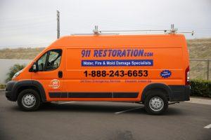 911-restoration-water-damage-mold-remediation-fire-damage-person-van